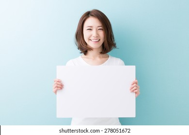 young attractive asian woman having a white board