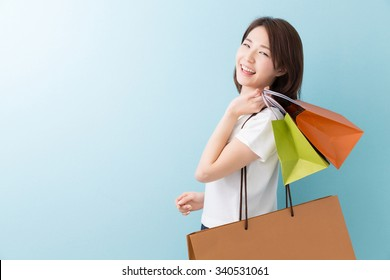 young attractive asian woman having shopping bags