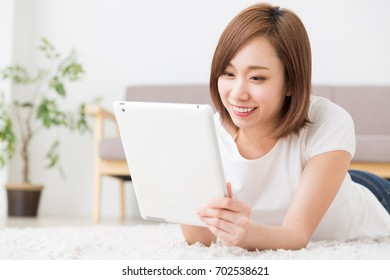 young attractive asian woman to see a tablet computer