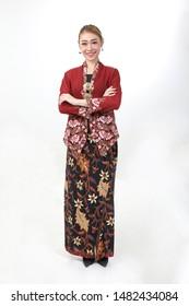 Young attractive Asian woman traditional red maroon nyonya kebaya sharong on white background