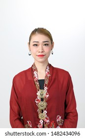 Young attractive Asian woman traditional nyonya kebaya sharong on white background