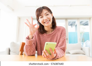 young attractive asian woman using a smart phone