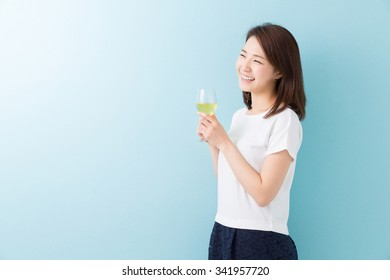 young attractive asian woman who drinks wine