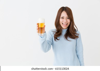 young attractive asian woman who drinks beer