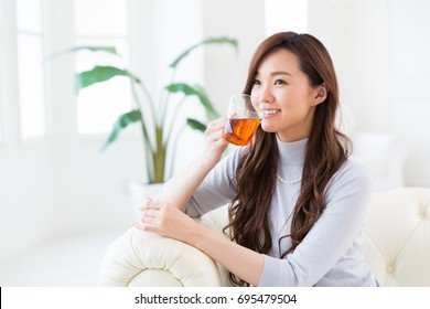 young attractive asian woman who drink tea