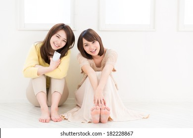 young attractive asian women  to see a smart phone