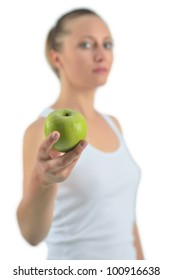 Young attractive athletic woman with green apple, isolated on white