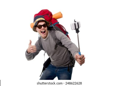 young attractive  backpacker tourist taking selfie photo with stick carrying backpack ready for travel and adventure on vacations route isolated on white background