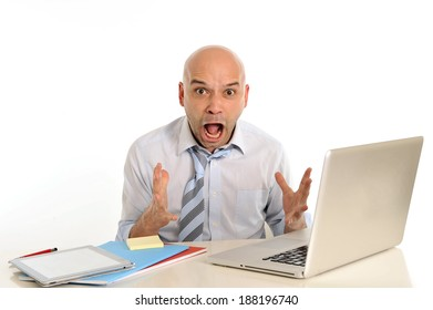 young attractive bald latin business man in stress , frustrated and desperate , going crazy working with computer at office desk