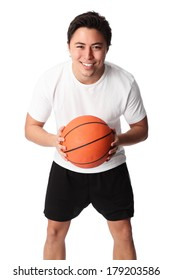 Young attractive basketball player wearing a white tshirt with black shorts, holding a basketball. White background.