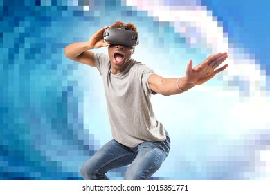 young attractive black afro American man using vr virtual reality 3D goggles playing surf videogame with pixelated computer sea wave background in gaming fun and new technology concept