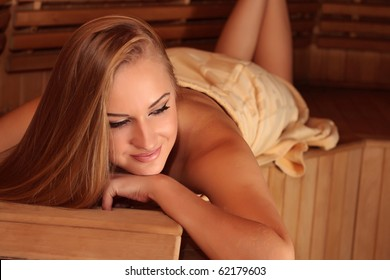 Young attractive blond woman in a steam room