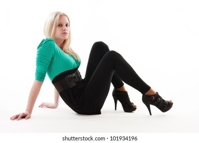 Young attractive blonde woman posing, white background