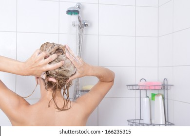 young attractive blondie woman taking a shower in bathroom