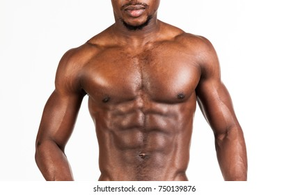 Young attractive bodybuilder sportsman with naked perfect fit body and beautiful athletic muscles, abs, biceps and arms. Standing and posing as model on abstract white background. Detailed studio shot