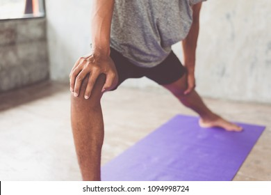 Young attractive boy exercising,asian man practicing meditation indoors, Yoga and Healthy lifestyle concept.