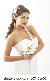 Young attractive bride with the bouquet of white roses