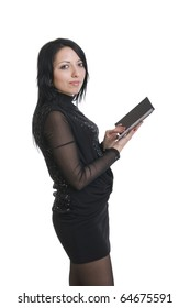 a young attractive brunette in black with notebook in hand