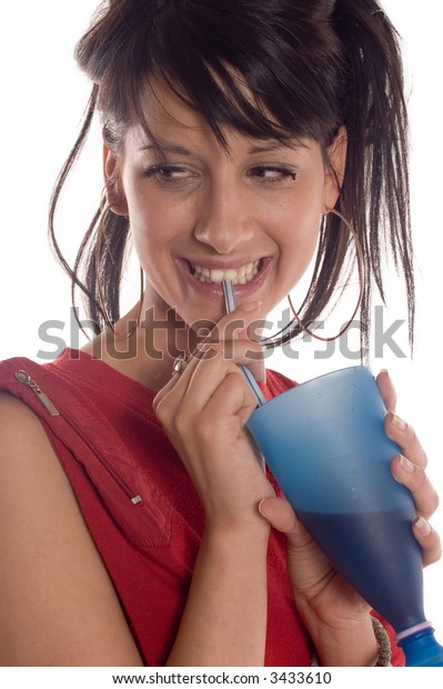 Young attractive brunette girl drinking a juice