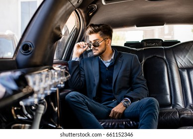 Young attractive business man in limousine