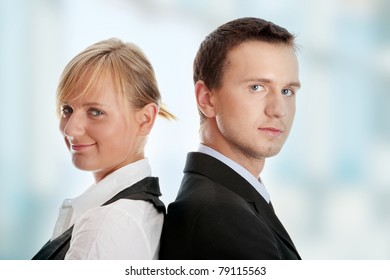 Young attractive business people at work