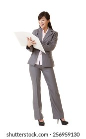 Young attractive business woman of Asian, full length portrait on white.