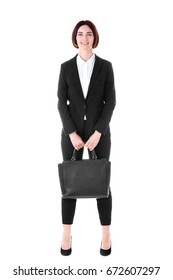 Young attractive business woman with black handbag and in black formal suit  isolated on white background.
