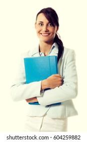 Young attractive business woman with briefcase at the office. Business concept. Toned image