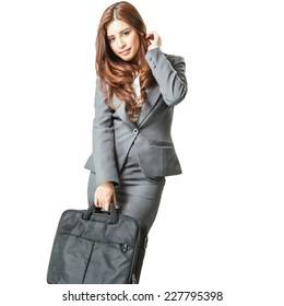 young attractive business woman with handbag isolated on white background