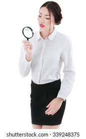 Young attractive business woman with a magnifying glass