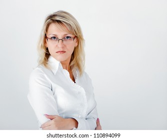 Young attractive business woman on a light background