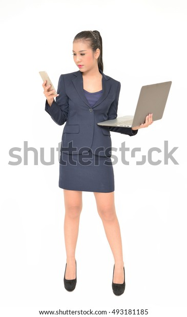 A young attractive business woman standing with a laptop and cell phone, ordering Trading Forex online service.