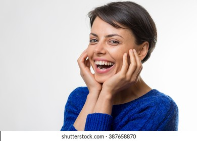 Young attractive business woman in a studio laughing