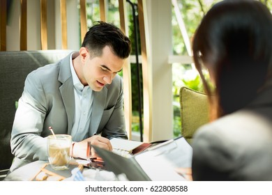 Young attractive businessman during job interview in the coffee shop.
