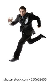 young attractive businessman with take away coffee running late to work wearing suit and tie hurry up to office in stress and overwork concept isolated on white background