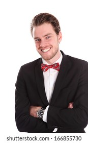 Young attractive businessman wearing a suit and bowtie, standing with his arms crossed. White background.