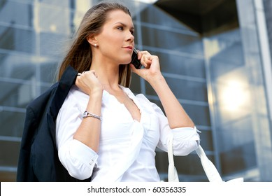 Young attractive businesswoman with a mobile phone