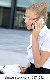 Young attractive businesswoman talking on the mobile phone