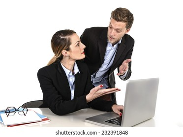 young attractive businesswoman working at computer laptop in office arguing with work colleague in stress fighting against each other in front of computer laptop in hard and annoying job relationship