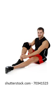 Young attractive caucasian man athlete suffering from pain in the knee. White background. Studio shot.
