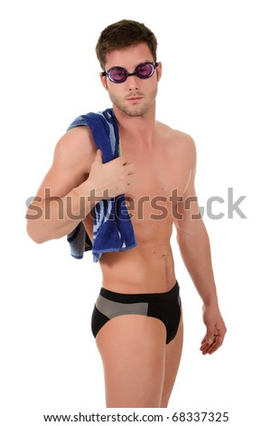 a56db6dbd8 Young attractive caucasian man swimmer with goggles and towel on shoulder. Studio  shot. White
