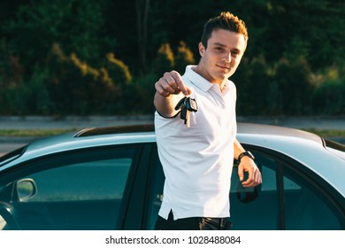 Young attractive caucasian man in white t-shirt