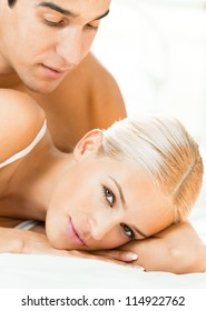 Young attractive couple at bedroom