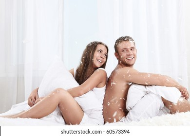 Young attractive couple in the bedroom