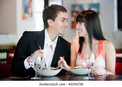 A young and attractive couple dining in a restaurant