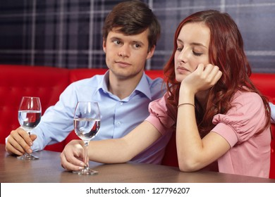 Young attractive couple enjoying sitting together in a restaurant