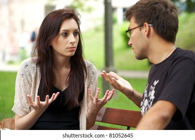 young attractive couple have an argument over something, outdoor shoot