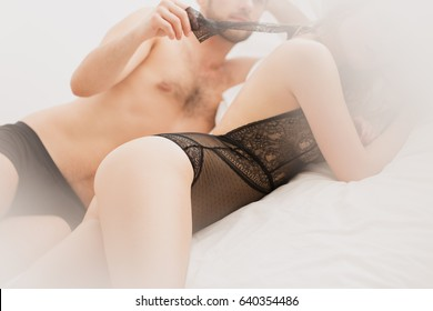 Young attractive couple laying in bed after sex