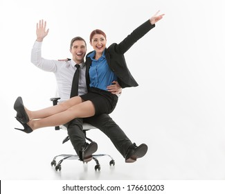 young attractive couple sitting on chair. two beautiful colleagues playing and laughing