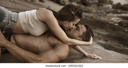 Young attractive couple spending time on a beach